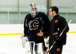 Heat Goalie Coach Scott Gouthro speaking with New Hampshire goalie Adam Clark on the ice (PHOTO BY ROB MCMORRIS)