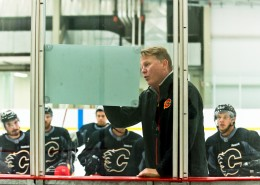 Assistant Coach Todd Gill using the white board to illustrate to Flames defenseman (PHOTO BY ROB MCMORRIS)