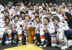 ZSC Lions' players celebrate with the trophy after defeating SC Bern (SCB).  Pittis is located in the first row, second from the right.  Calgary Flames current Head Coach Bob Hartley can be seen in the suit located just behind the new Stockton Heat assistant.