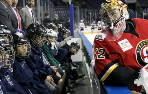 Jon Gillies chats with the Stockton Colts players on the bench during warm-ups (PHOTO BY JACK LIMA).